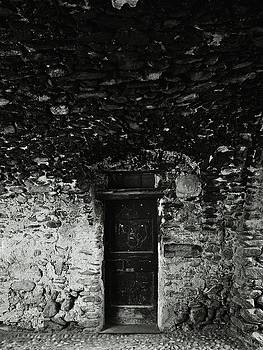Old door under the porch by Ettore Zani