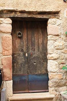 Old door with knocker by Dennis Curry