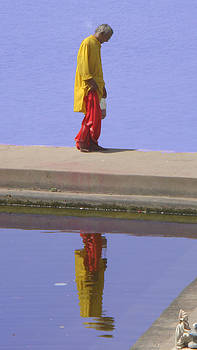 Old Indian man staring at  the water by Gili Hg