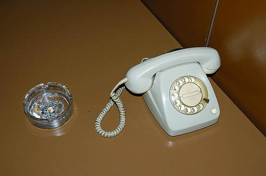 Old phone with dial plate by Matthias Hauser