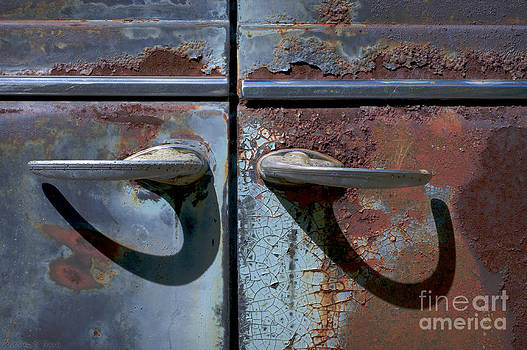 Old Rusty Plymouth Door Handles with Shadows by Warren Sarle