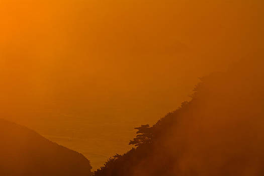 Orange sunset Hongpo South Korea by Gabor Pozsgai