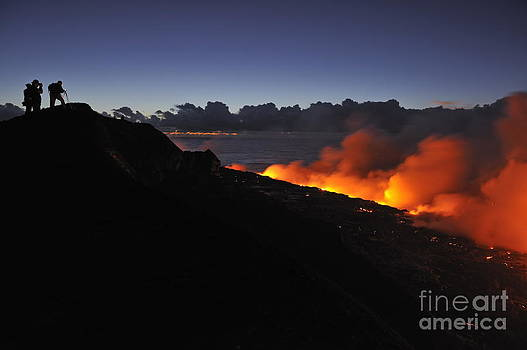 Sami Sarkis - People watching lava flowing to the sea at sunrise
