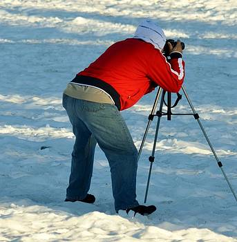 Photographer In Action by Ami Tirana