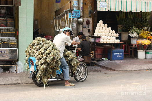 Pineapple Vendor in Saigon by Ann Kaufman