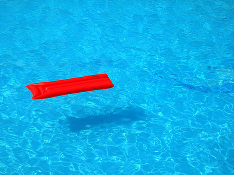 Pool - blue water and red inflatable mattress by Matthias Hauser