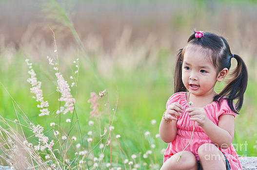 Portrait of little Asian girl  by Sattapapan Tratong