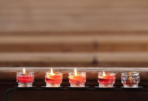 Prayer candles in church by Matthias Hauser