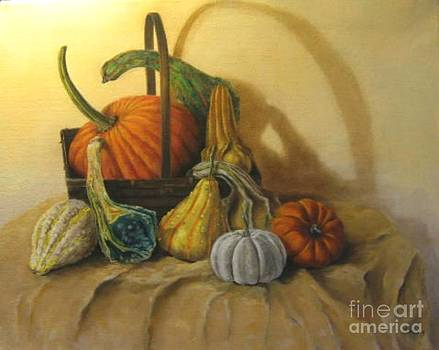 Pumpkin in a basket by Patricia Lang