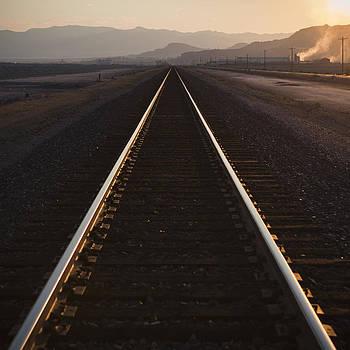 Railroad Tracks At Dusk by Paul Edmondson
