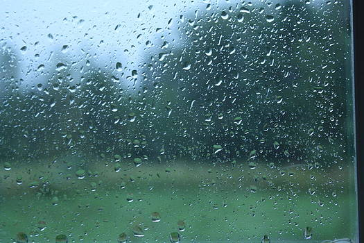 Rain drops on a window in maine by Alexis  Hawes