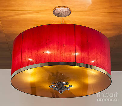 Red circles chandelier  by Chavalit Kamolthamanon
