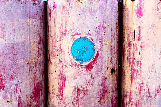 Red pipe with vibrant blue circl by Anya Brewley schultheiss