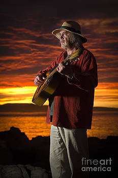 Red sky guitarist by David Lade