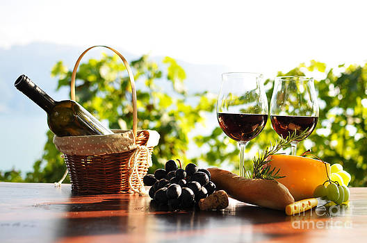 Red wine grapes and cheese by Alexander Chaikin