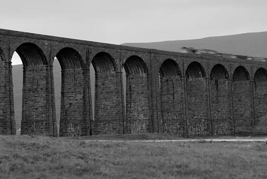 Ribblehead Viaduct with Train by Andy Comber