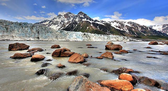 River Flowing Against Alaskan Glacier by Wyatt Rivard