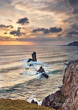 Rocks In The Ocean by Derek Smyth
