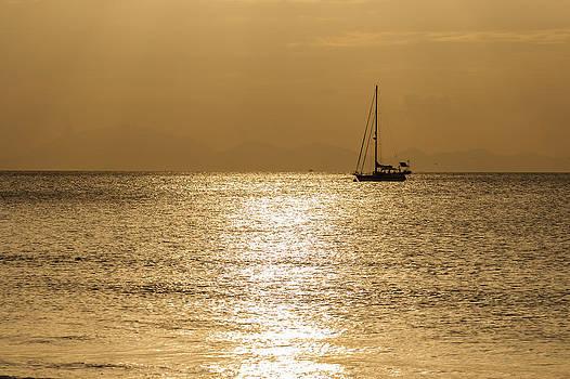 Sailing boat on beautiful sunset by Panya Jampatong