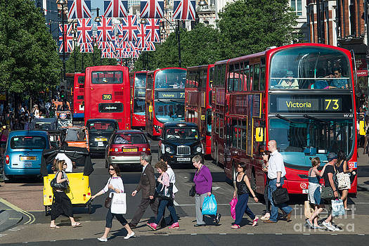 Shoppers and red buses by Andrew  Michael
