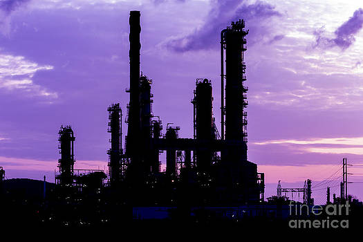 Silhouette Of Oil Refinery Plant At Twilight Morning by Mongkol Chakritthakool