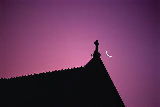 Silhouette Of Roof With Crescent Moon by Paul Simcock