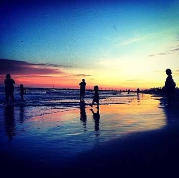 Silhouettes on the Shore by Caitlyn Stykowski
