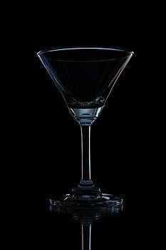 Single Empty Wine Glass by Kobchai Sukruean