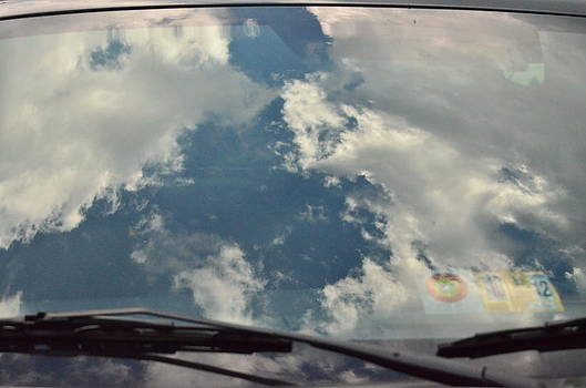 Sky Reflected on a Truck Window by Mark Stidham
