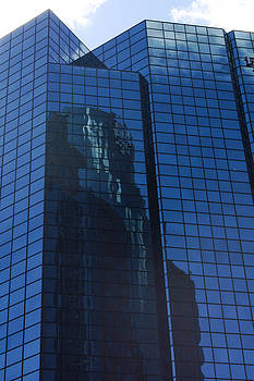 Sky Reflecting on building  by Pierre-Marc Cardinal