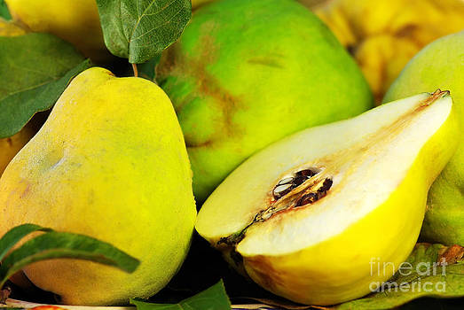 Slice Of Quince Fruits On Basket by Inacio Pires