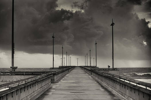 Stormy Pier  by Daniel Daugherty
