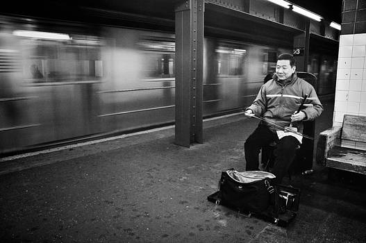 Street Musician in Subway Station in New York City by Ilker Goksen