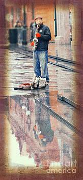 Street Musician Reflection by Jeanne  Woods