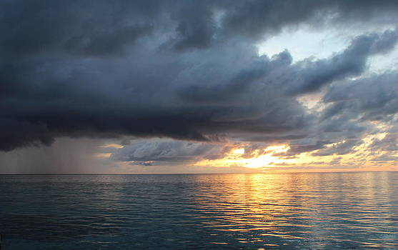 Sun and Rain in The Maldives by Denise Dean