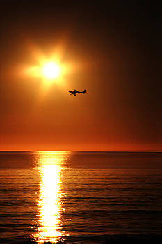 Sun sets on airplane  by Edgar  Mena