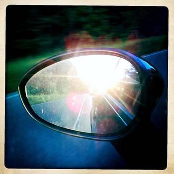 Sunlight in the rear mirror by Matthias Hauser