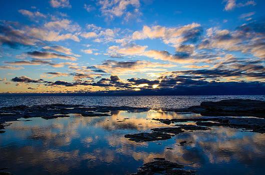 Sunrise Reflection  by Todd Heckert