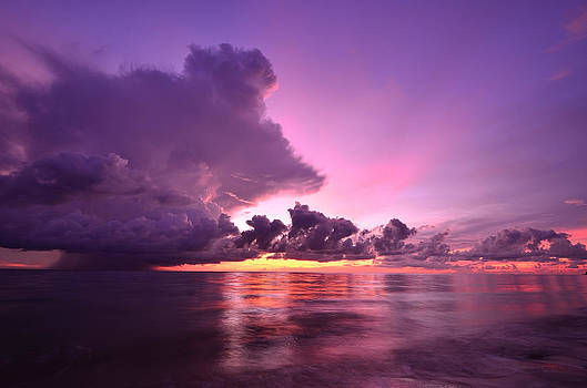 Sunset and storm front with rain over the sea by Kanoksak Detboon