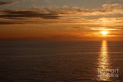 Sunset in the Pacific Ocean by Robert Wirth