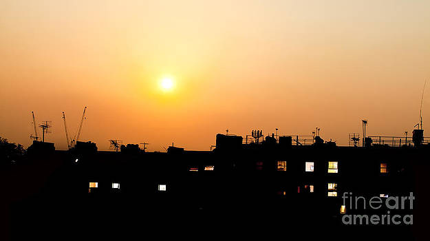 Simon Bratt Photography LRPS - Sunset over rooftops with building lights