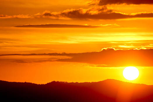 Sunset over Waitakere ranges by Mathew Tonkin Henwood