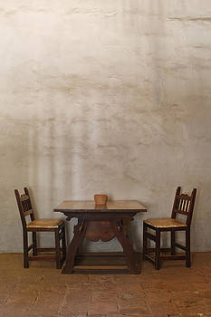Table And Chairs In Adobe Building by Douglas Orton