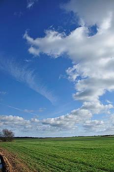 The clouds go round and round by Gabi Dziok-Grubb