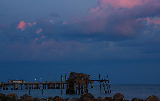 The Dock under the pink sky by Mike Wilber
