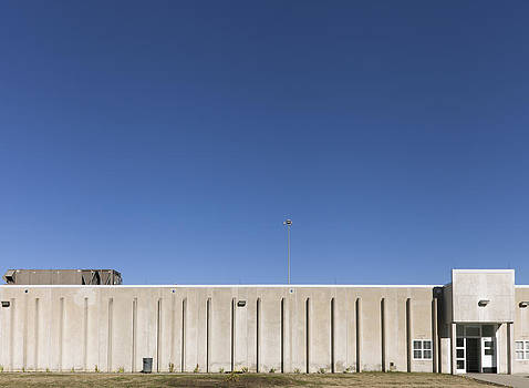 The Exterior Of A Concrete Building by Roberto Westbrook