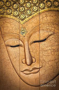 The face of Buddha  by Sattapapan Tratong