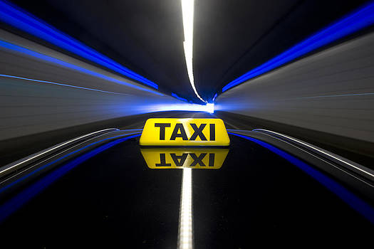The Yellow Roof Sign Of A Taxi. A Cab by Corepics