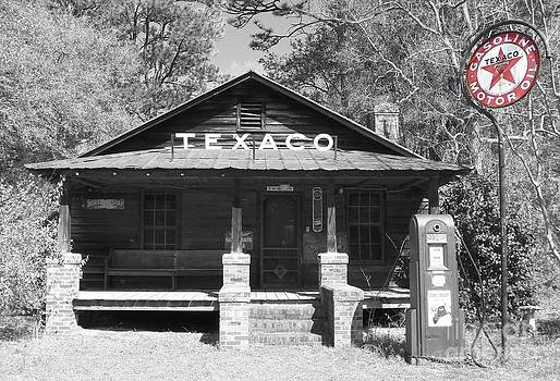 This Old Texaco Station Black and White by Melanie Snipes