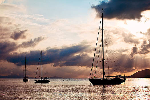 Three yachts on the sea at sunset in the Virgin Islands by Anya Brewley schultheiss